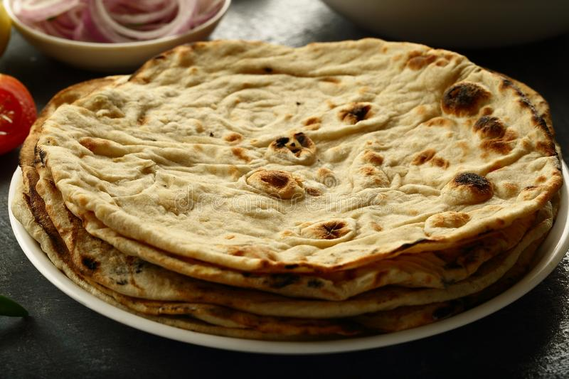 Tandoori roti from Indian cuisine.vegetarian meal. Healthy vegan diet food- homemade roti served with chickpea curry channa masala stock image