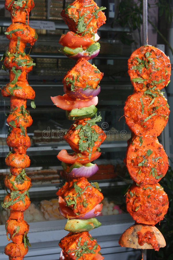 Tandoori vegetables. Spicy mushrooms and other vegetables on skewers roasted in a clay oven stock photos