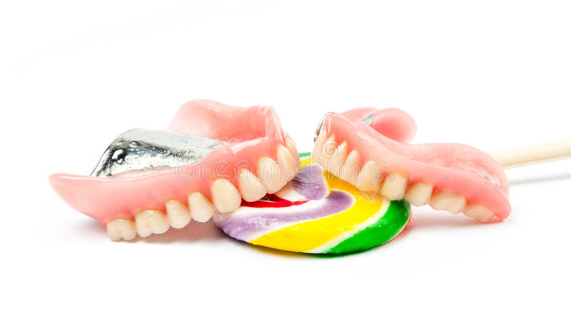 Tandproteser med klubbor royaltyfri fotografi