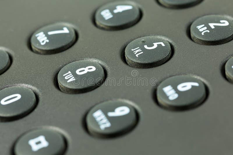 Tangentbord med att kartlägga för bokstav av en svart telefon fotografering för bildbyråer