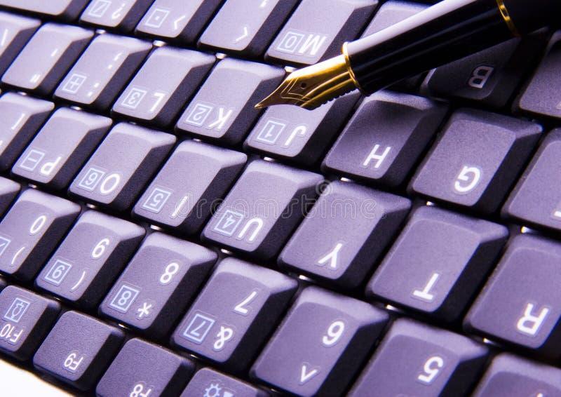 tangentbordpenna royaltyfria bilder