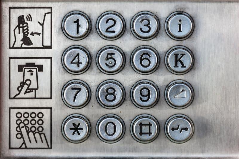 Tangenter av en payphone arkivfoto