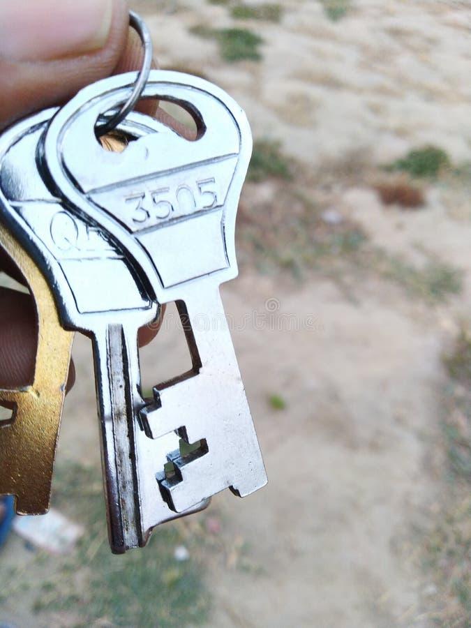 Tangenter låser för hardworkmaskinvara för framgång nyckel- säkerhet för järn arkivbild