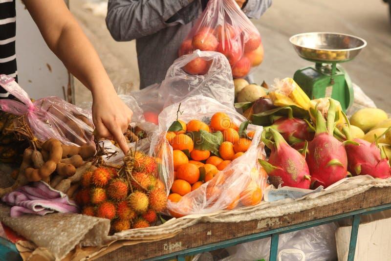 Tangerin dragon fruit rambutan mango fruit on market. Tangerin dragon fruit rambutan mango fruit chioce on vietnam market royalty free stock image