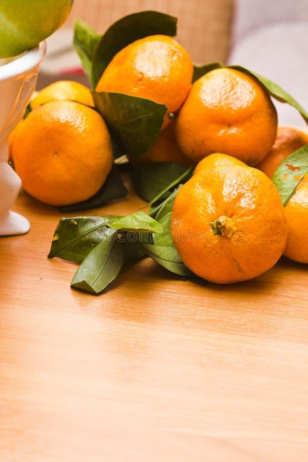 Tangerin på en tabell fotografering för bildbyråer