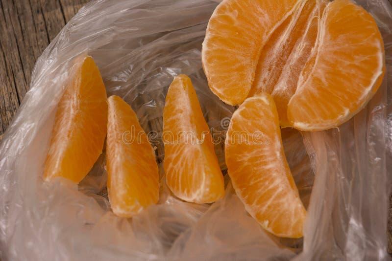 Tangerine. Fruit with one partly peeled stock photo