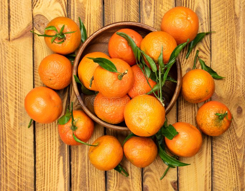 Tangerine fruits over old wooden background, top view, overhead stock photo