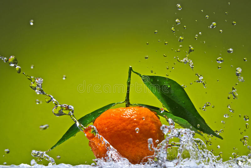 Tangerine With Green Leaves On Green Background Stock Image
