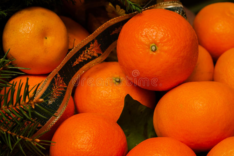 Tangerine. Mandarin. Solar fruit with energy of the sun, symbol happiness, wealth and success. Traditional dessert at Christmas and New year royalty free stock image