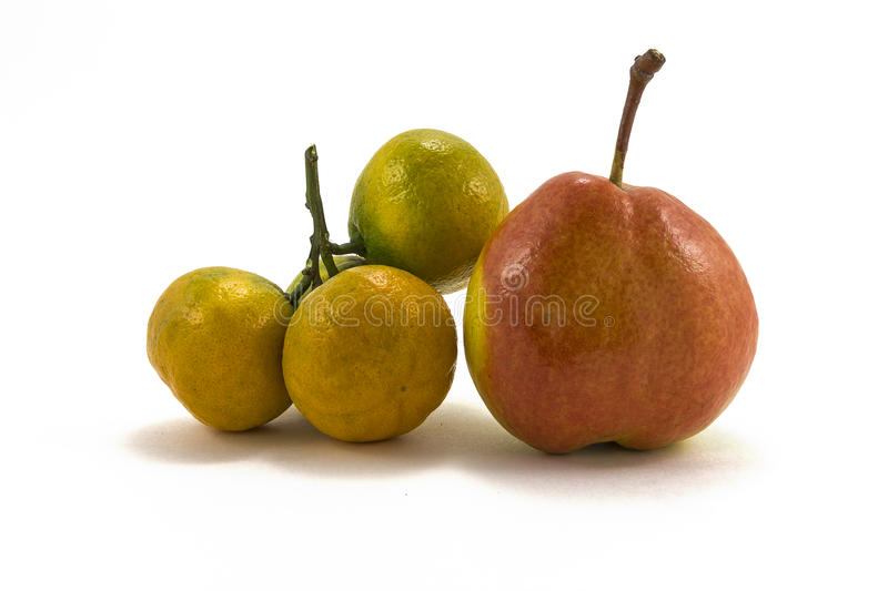 Tangerine and pear on a white background stock image
