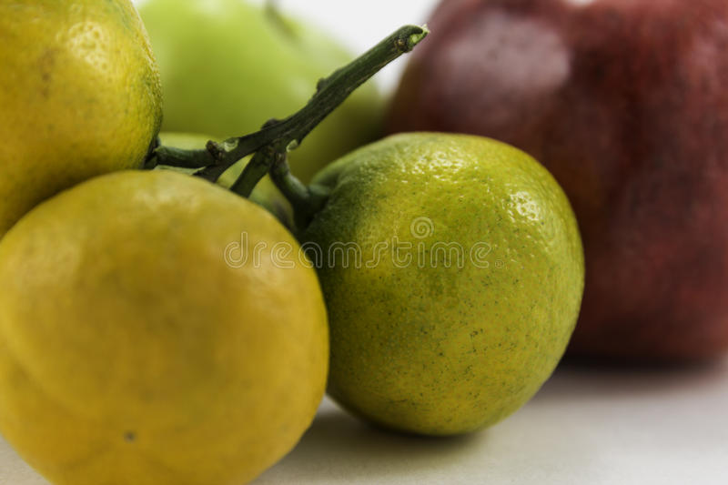 Tangerine and pomegranate on white background royalty free stock photography