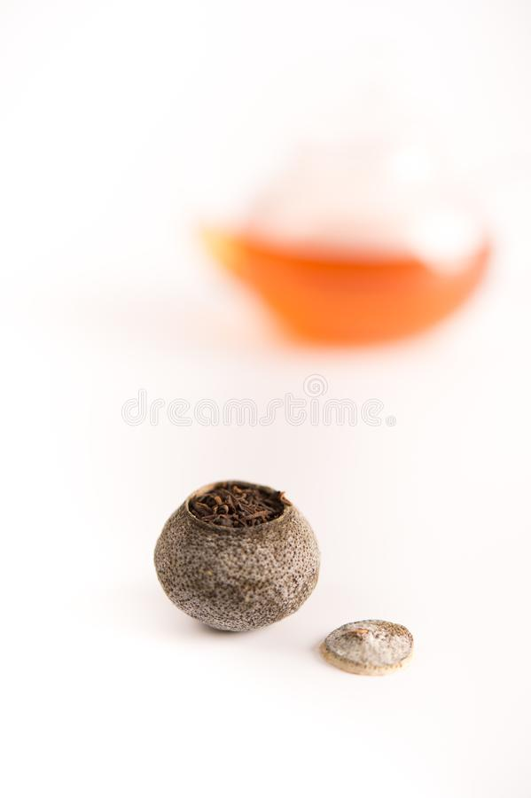 Tangerine puer tea. Close up studio shot of tangerine puer tea on white background, and this can be used as health care elements royalty free stock image