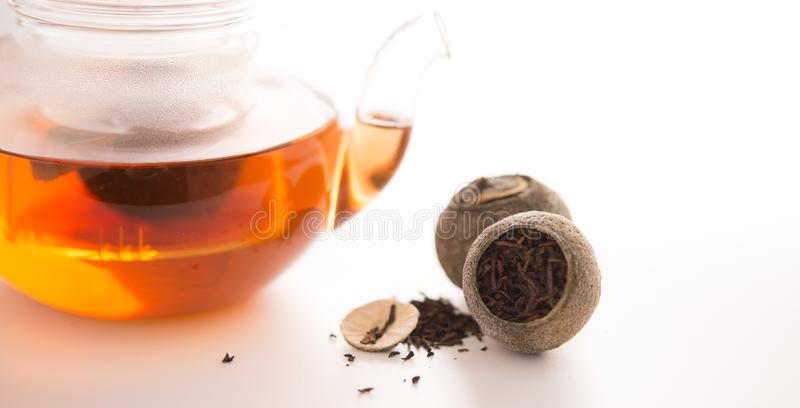 Tangerine puer tea. Close up studio shot of tangerine puer tea on white background, and this can be used as health care elements stock images