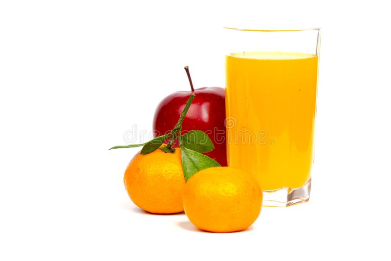 Tangerines, γυαλί μήλων και χυμού στοκ εικόνα