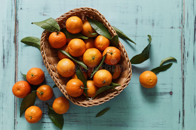 Tangerines. Basket of Tangerines on a wooden table stock images