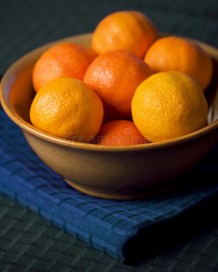Download Tangerines In Bowl On Blue Placemat Stock Photo - Image: 13345574