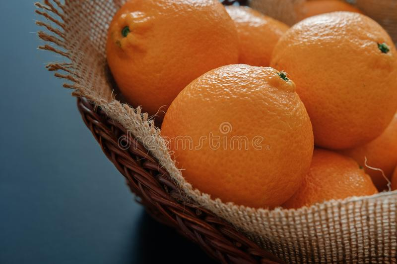 Tangerines clementines in wicker basket with burlap royalty free stock images