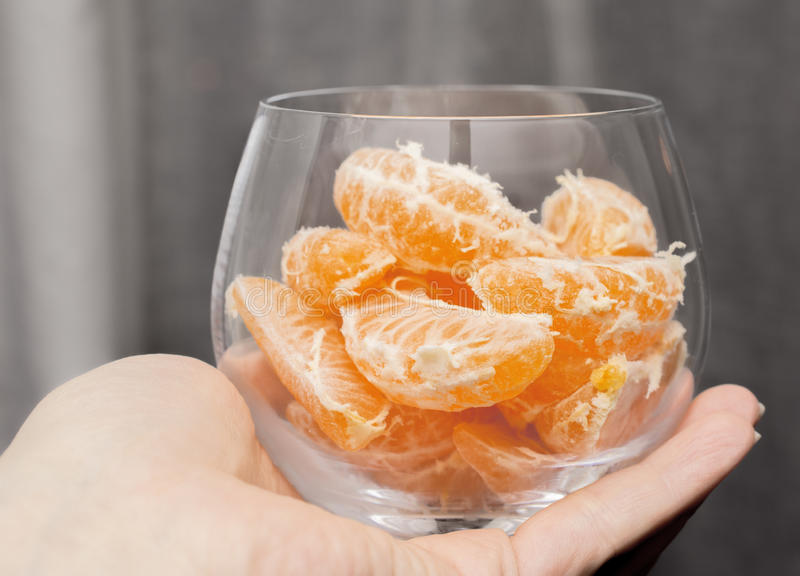 Download Tangerines in a glass vase stock photo. Image of table - 83704382