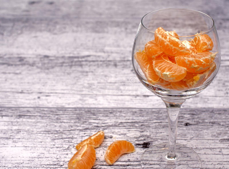 Download Tangerines in a glass vase stock photo. Image of mandarin - 83705294