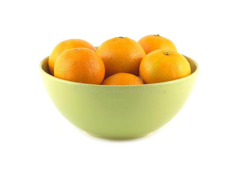 Tangerines in green china bowl isolated royalty free stock photography