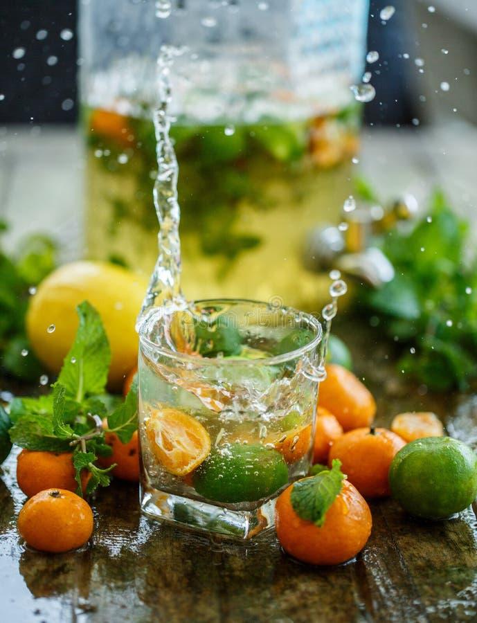Tangerines and lemon lemonade with splashes. Tangerine and lemon lemonade with splashes stock photos