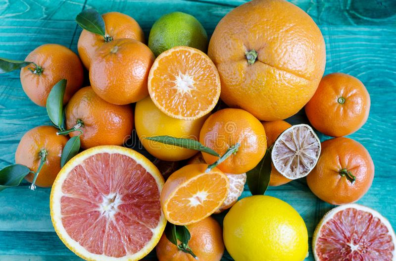 Tangerines lemons oranges lime citrus close-up on green background copy space stock image
