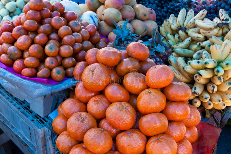 Tangerines, Market Day, Pisac, Peru. The market at Pisac, in the Urubamba Valley near Cusco, features a wide variety of fruits and vegetables royalty free stock photo