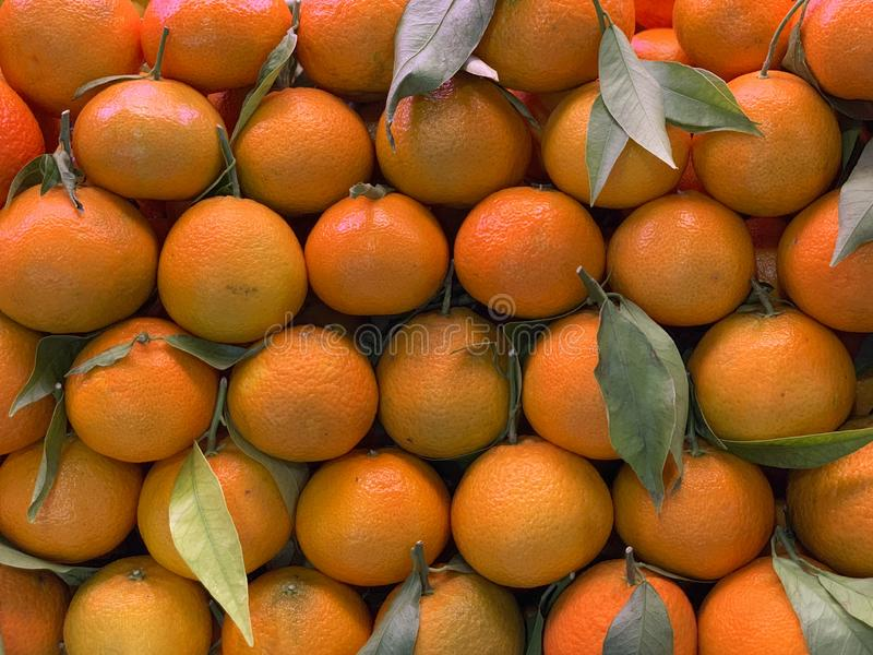 Tangerines on market Stall for sale stock images