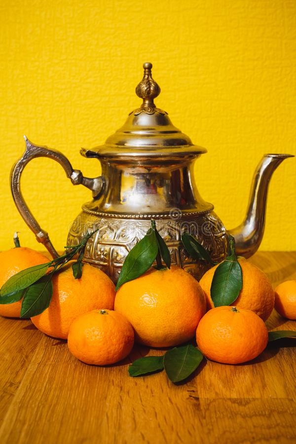 Tangerines and teapot from Morocco royalty free stock photos