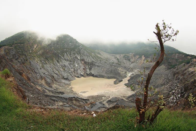 Tangkuban perahu volcano. Tangkuban Perahu, or Tangkuban Parahu in local Sundanese dialect, is an active volcano 30 km north of the city of Bandung, the royalty free stock photo