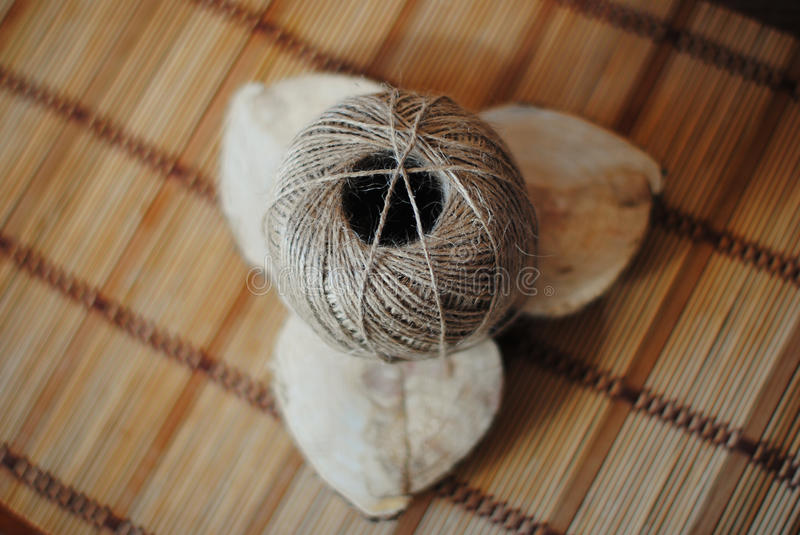 Tangle of jute twine on a wooden stand handmade. Tangle of jute twine on handmade wooden stand stock photo