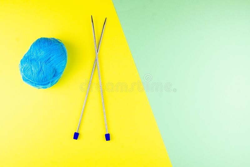 Tangle and knitting needles royalty free stock photos