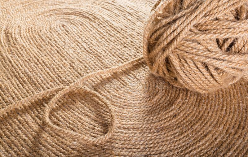 Texture of handmade carpet. Tangle of rope close-up on texture of handmade carpet royalty free stock images