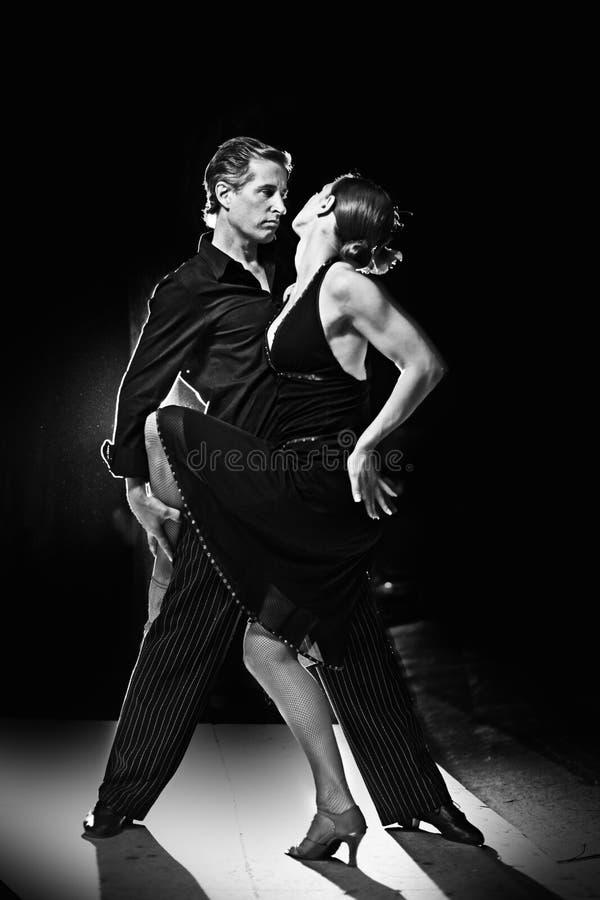Tango dance. Couple dancing hot latin dance on a street at night