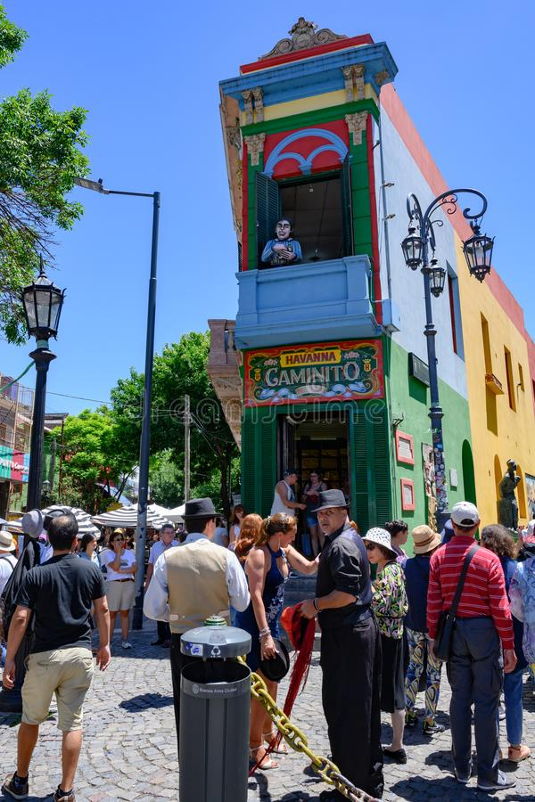 Tango Dancers and Tourists in La Boca, Buenos Aires, in front of colorful painted house in Caminito royalty free stock photos