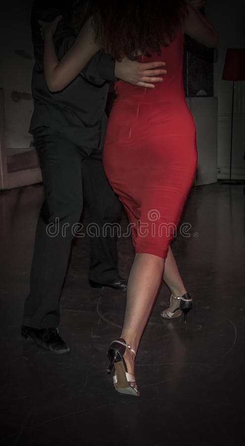 Tango Dancing. A pair dancing tango on a masquerade party royalty free stock images