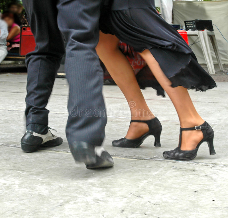 Tango feet. Argentinian couple dancing in San Telmo, Buenos Aires captured with motion blur