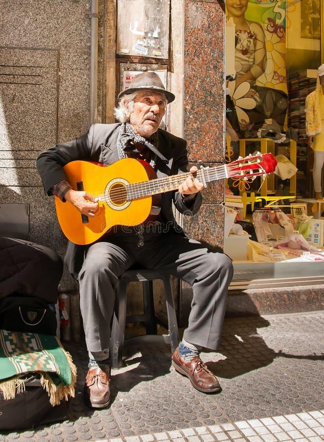 Tango guitar player stock photography