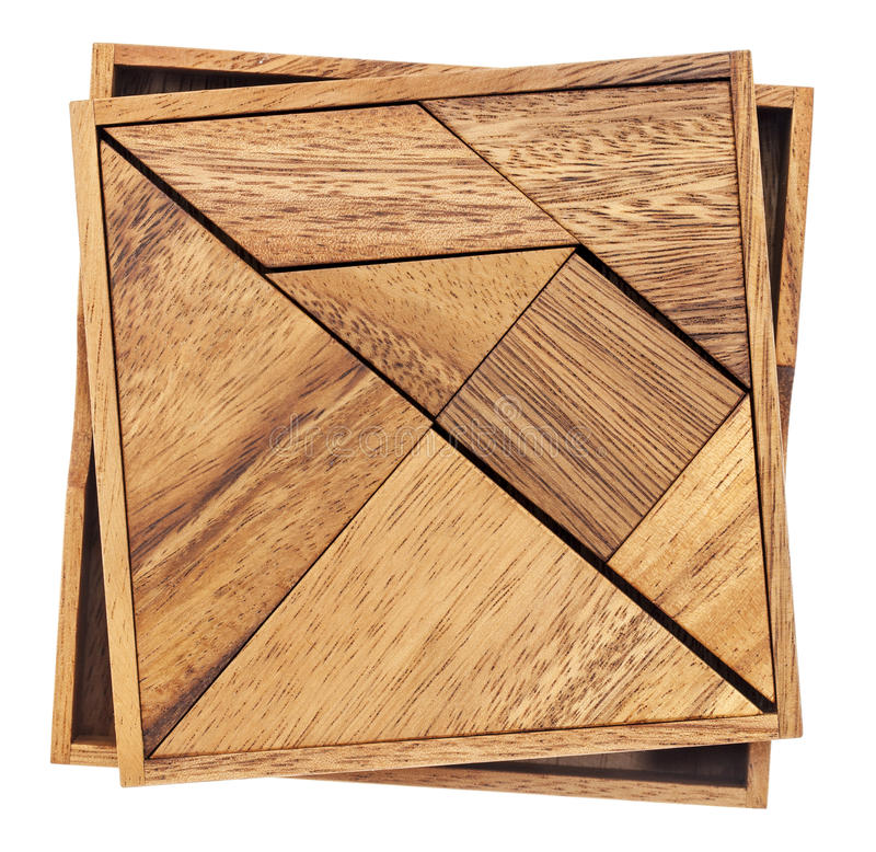 Tangram - Chinese puzzle game. Tangram, a traditional Chinese Puzzle Game made of different wood parts to build abstract figures from them, isolated on white royalty free stock photography