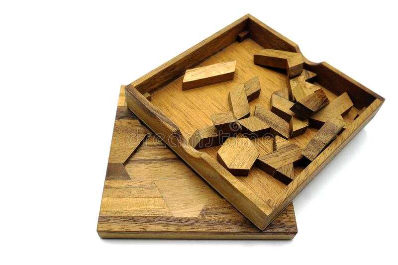 Tangram, Chinese traditional puzzle game. Made of different wood parts that come together in a distinct shape, in a wooden box stock photography