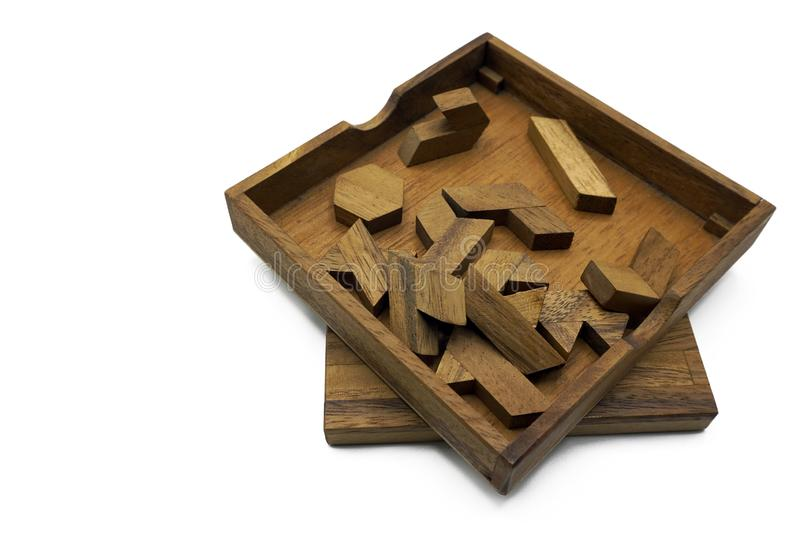 Tangram, Chinese traditional puzzle game. Made of different wood parts that come together in a distinct shape, in a wooden box stock photo