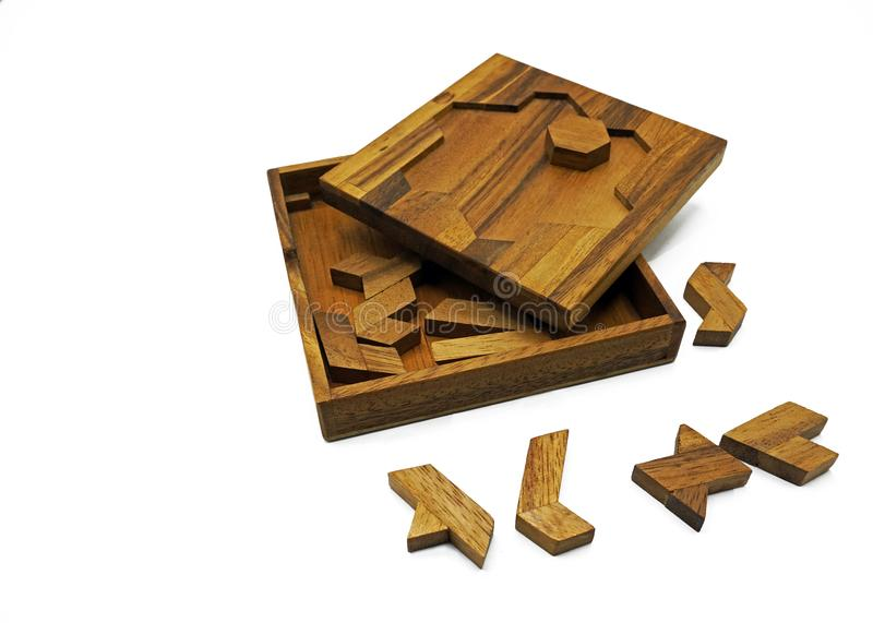 Tangram, Chinese traditional puzzle game. Made of different wood parts that come together in a distinct shape, in a wooden box royalty free stock photos