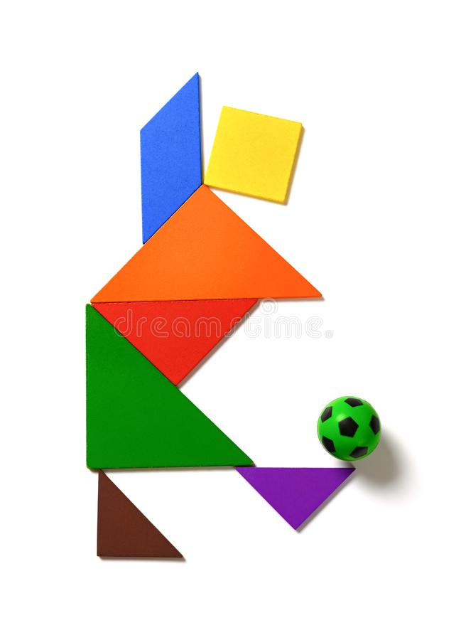 Tangram shaped as a player dribbling a soccer on white background. Tangram shaped as a player  dribbling a soccer on white background royalty free stock photo