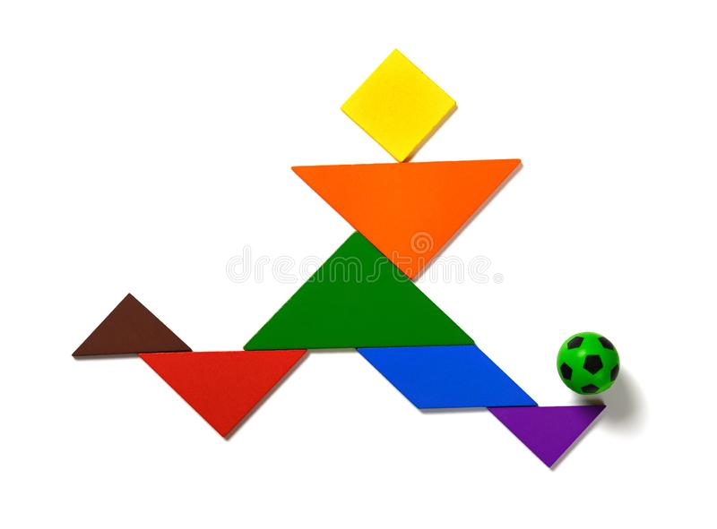 Tangram shaped as a player dribbling a soccer on white background. Tangram shaped as a player  dribbling a soccer on white background royalty free stock photography