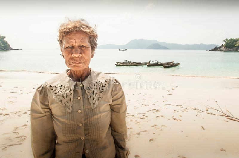 Old Moken women on the sand beach. Sea gypsy, Moken live a semi-nomadic hunter-gatherer lifestyle heavily base on the sea. Pearl. Tanintharyi, Myanmar – royalty free stock image