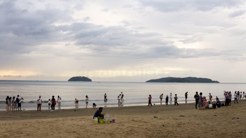 The view of tourist visit Tanjung Aru Beach waiting for sunset in Kota Kinabalu stock image