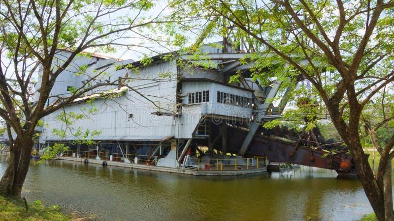 Tanjung Tualang abandoned silver mining dredge during British colonial stock image