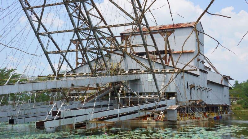 Tanjung Tualang verliet zilveren mijnbouwbaggermachine tijdens Britse koloniaal royalty-vrije stock foto's
