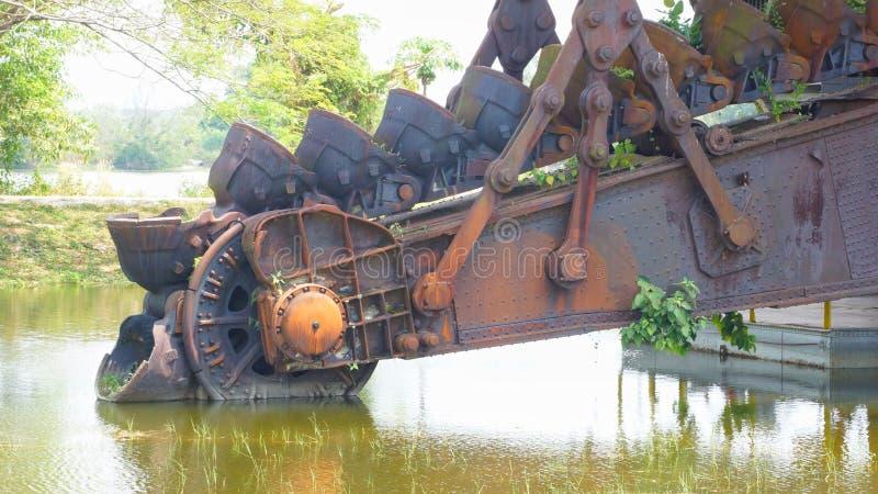 Tanjung Tualang verliet zilveren mijnbouwbaggermachine tijdens Britse koloniaal royalty-vrije stock fotografie