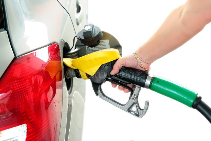 Tank benzine in gas-post bij stock foto's